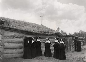 Nuns in front of the Saint Labre mission, Ashland, Montana (b/w photo)