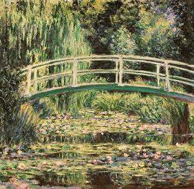 Bridge in Monets garden with white waterlilies