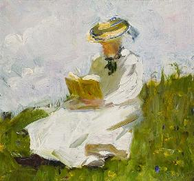 Reading woman in the greenery