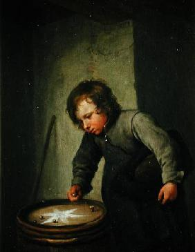 Boy Playing with Marbles