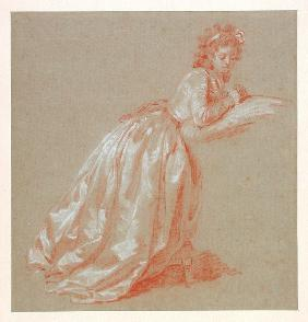 Young woman kneeling