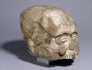 Portrait skull with cowrie shell eyes, Jericho, c.7th millennium BC (skull, plaster, shell) (3/4 vie