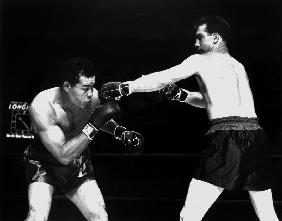 American boxer Joe Louis fighting with Billy Conn