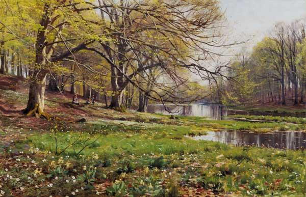Riverside in spring with playing children