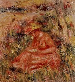 Young woman with hat in a reddish landscape.