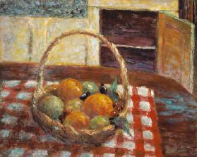 Basket of fruit on a table