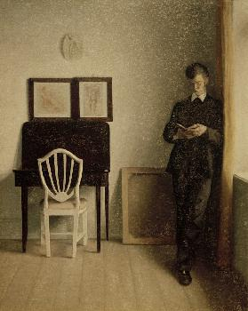 Interior with reading young man
